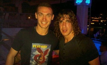 Thomas Vermaelen snapped getting pally with Barcelona's Carles Puyol in Ibiza