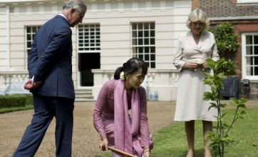 Suu Kyi greeted by Prince Charles and Camilla as she continues British tour