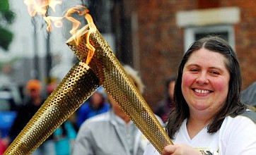 Torch relay fires charity spirit on its way to London Games