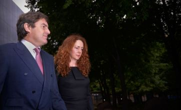 Phone hacking: Rebekah Brooks and husband Charlie in court