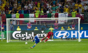 England fan flashes Italy's Alessandro Diamanti during Euro 2012 penalties