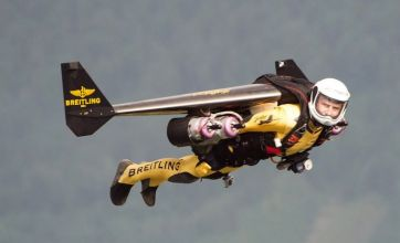 Daredevil pilot Yves 'Jetman' Rossy stuns plane passengers with flyby