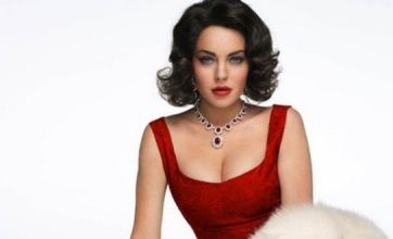 Lindsay Lohan shows off Elizabeth Taylor outfit as nude rumours emerge