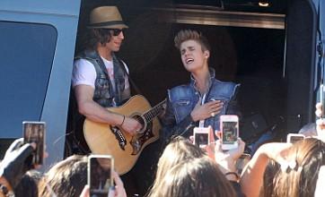 Justin Bieber treats fans to sing-along version of Boyfriend in California