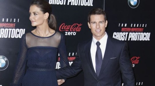 DECEMBER 2011: Tom Cruise and Katie Holmes arrive for the premiere of Mission: Impossible - Ghost Protocol in New York