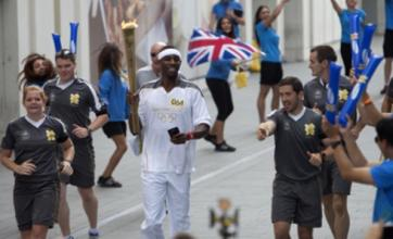 Phillips Idowu 'emotional' as he carries Olympic torch in Stratford