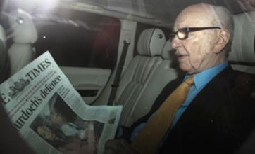 Rupert Murdoch steps down from News International board