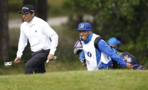 Carlos Tevez's caddying efforts didn't help Andres Romero (PA)