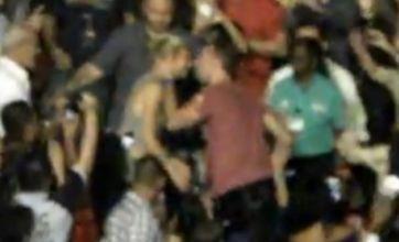 Chris Martin shocks Gwyneth Paltrow with a kiss during Coldplay gig