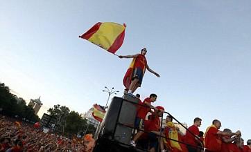 Alvaro Arbeloa leaps off top deck of Spain party bus
