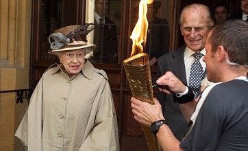 The Queen, a streaker and sporting legends join Olympic torch relay