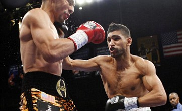 Amir Khan hits back at Carl Froch retirement jibe and vows to fight on