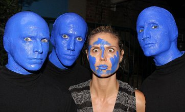 Heidi Klum clowns around with Blue Man Group after New York show