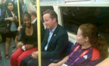 David Cameron and Jacques Rogge use public transport at London 2012