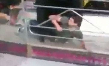 Two teenage boys thrown into air by loose car on spinning ride at funfair
