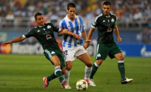 Isco (centre) looks set to stay at Malaga after Spurs had a bid rejected (AFP/Getty Images)