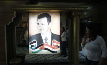Thousands flee Syria bombardment as Bashar al-Assad faces scrutiny on TV