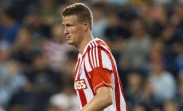 Stoke City centre-back Robert Huth has suspected meningitis