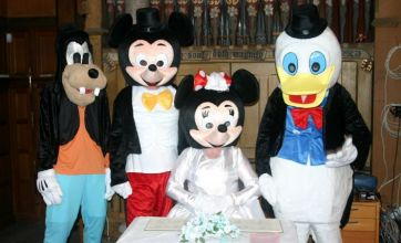 Couple renew wedding vows dressed as Mickey and Minnie Mouse
