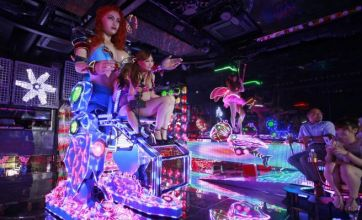 Japanese restaurant opens with giant female robots and bikini-clad dancers