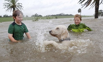 New Orleans avoids worst of Isaac as hurricane downgraded to storm
