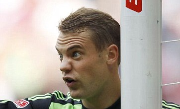 Bayern Munich keeper Manuel Neuer hits injured team-mate on the head