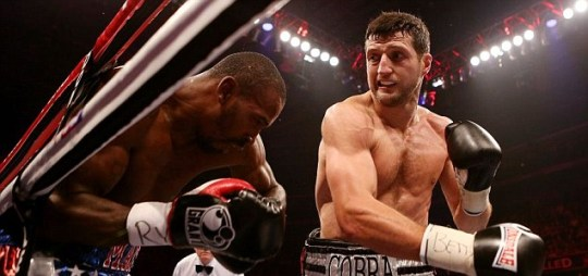 Carl Froch (R) in action with Yusaf Mack