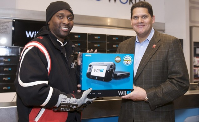 Nintendo of America boss Reggie Fils-Aime hands out the first Wii U