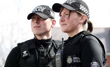 Police looking to ditch 'scary' all-black uniform for more traditional clothing
