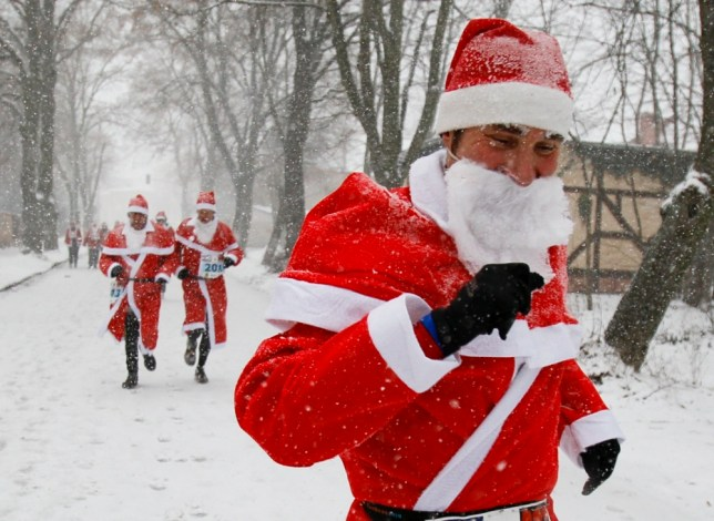 Runners dressed as Santa Claus take part in a charity run in Germany