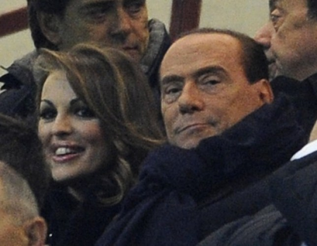 Date night: Berlusconi and Miss Pascale watch AC Milan in Milan earlier this month (Picture: Getty)