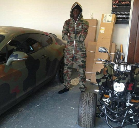 Mario Balotelli, camouflage onesie.