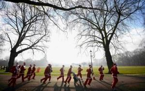 Competitors-dressed-as-Santa-Claus-take-part-in-the-annual-6-km-Santa-Run-in-Battersea-Park-AY_98936193.jpg