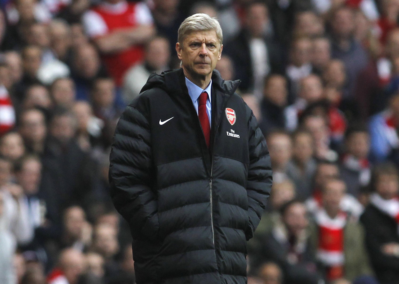 Arsene Wenger expects a strong response from Arsenal at Reading (AP Photo/Sang Tan)