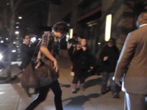 Harry Styles arrives at Taylor Swift's hotel…with overnight bag