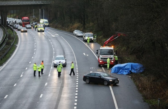 Emergency workers attend the scene of the crash on the M6 (Picture: Getty)