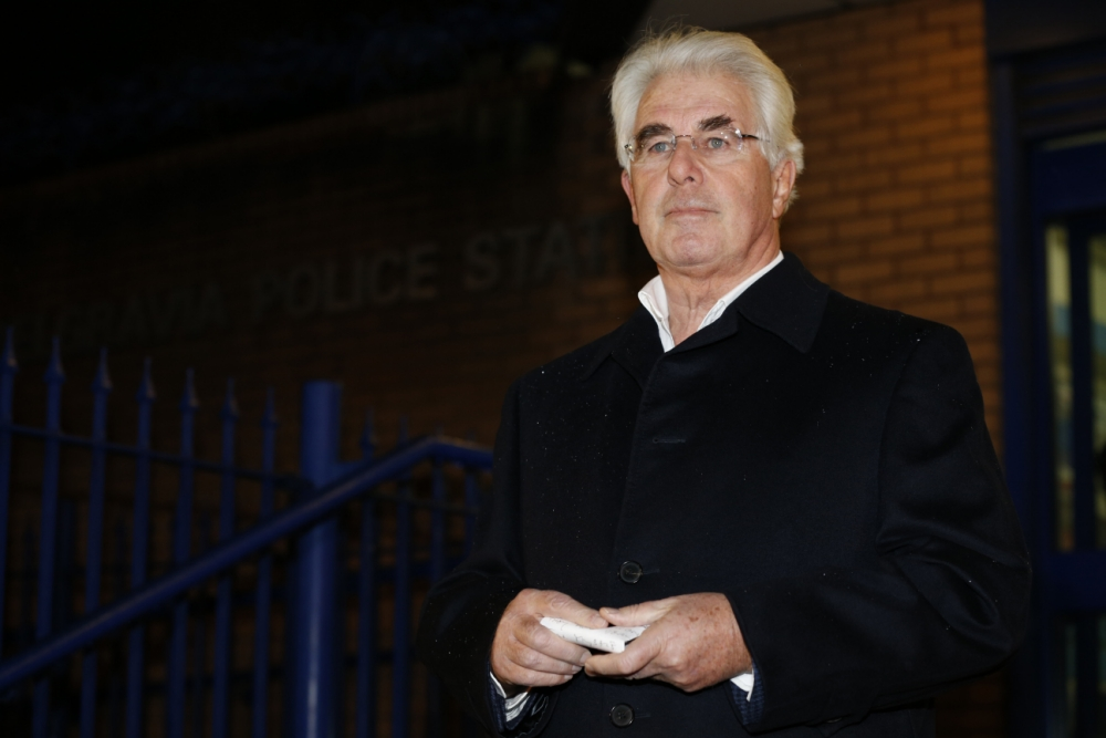 Max Clifford talks to journalists outside Belgravia police station