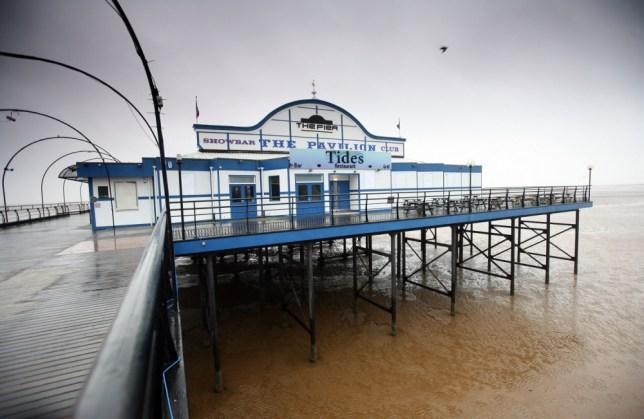 Beach club: The 100m pier (Picture: Kippa Matthews)