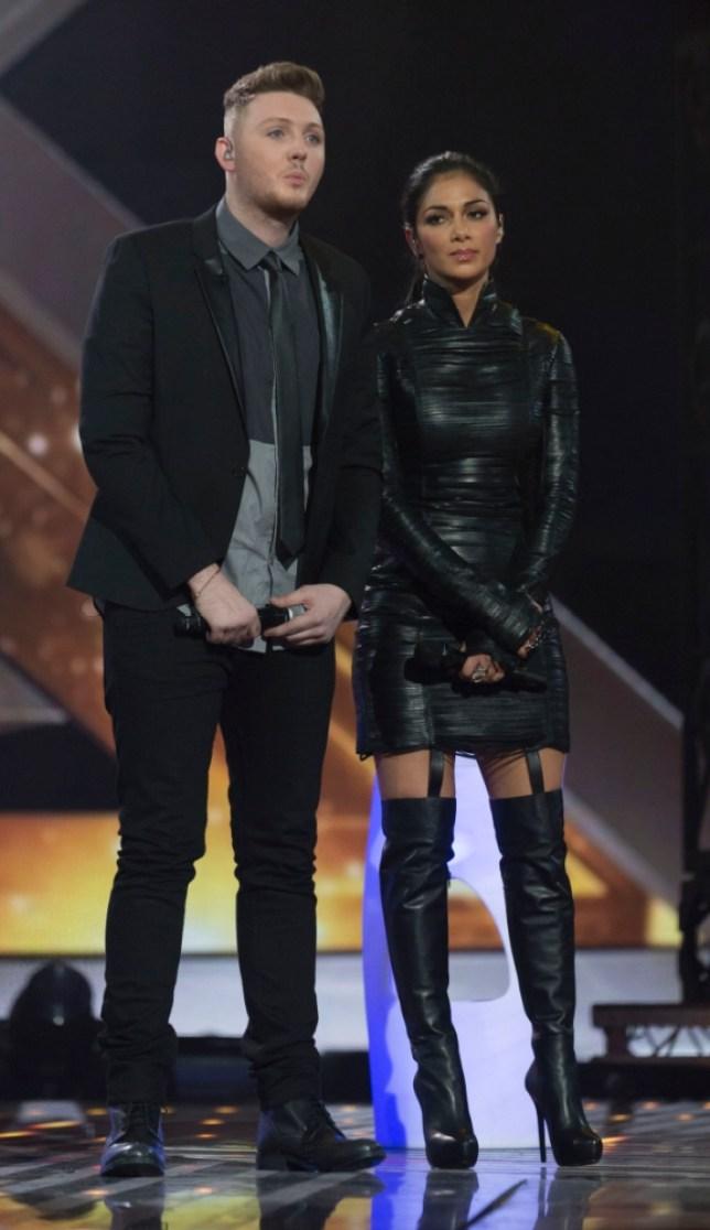James Arthur and judge/mentor Nicole Scherzinger (REX)