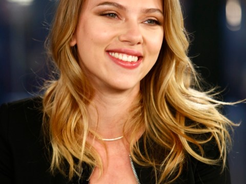 Scarlett Johansson and new beau Romain Dauric pucker up