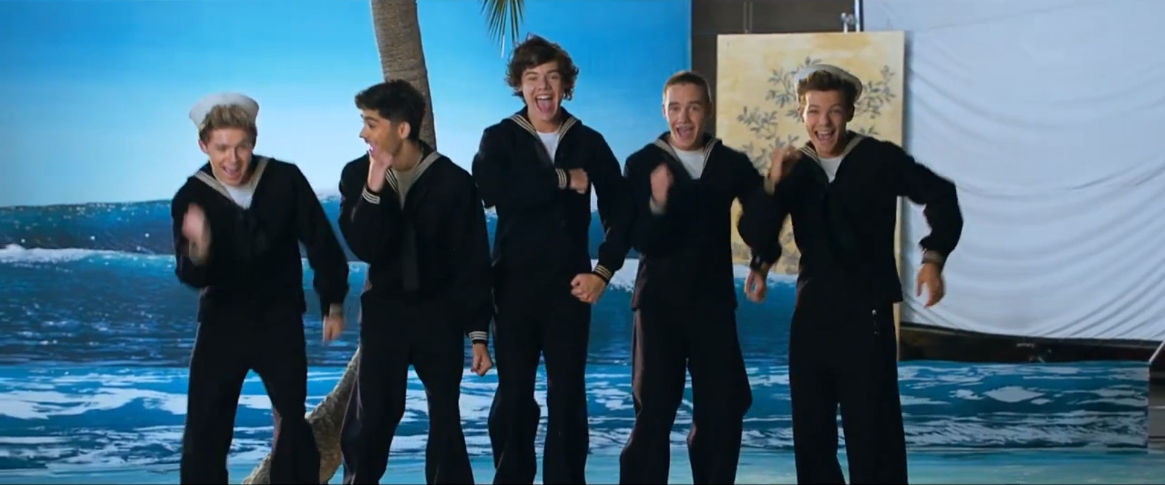 One Direction unveil camp new music video for Kiss You – Watch here