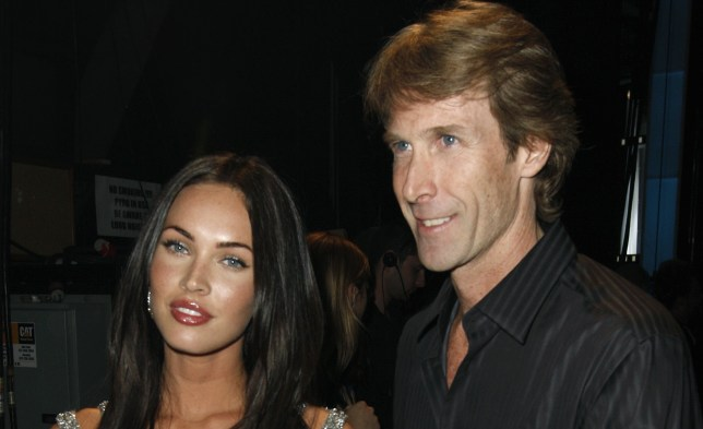 Michael Bay poses with former Transformers star Megan Fox (Picture: AP)