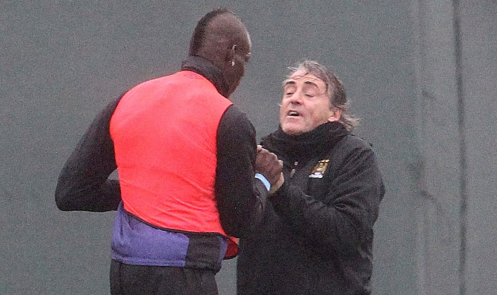 Drama: Roberto Mancini looks frightened as a furious Mario Balotelli confronts him (Picture: Eaamon and James Clarke)