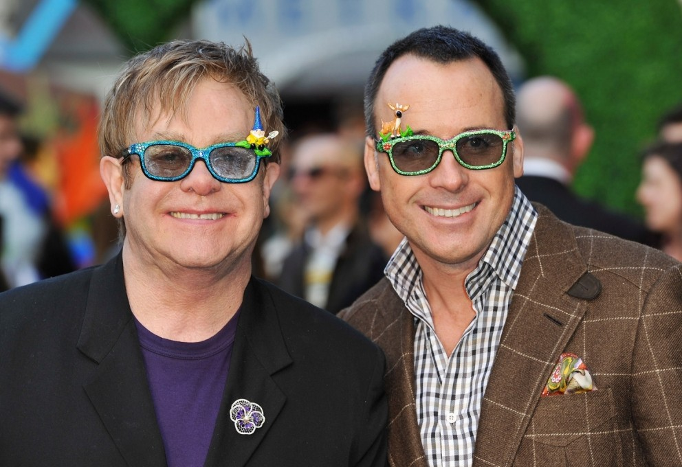 Elton and David ready for a party. (Photo by Gareth Cattermole/Getty Images)