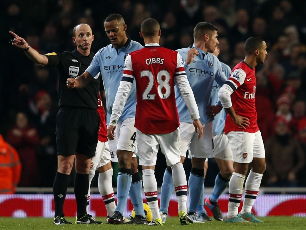 Kompany is sent off by referee Mike Dean (Picture: Reuters)