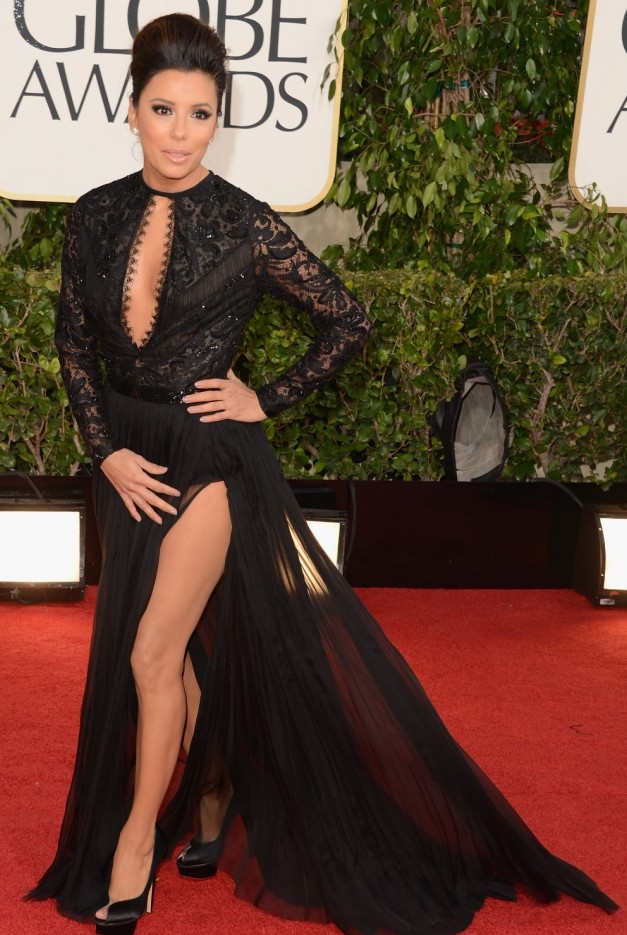Eva Longoria and Halle Berry do 'an Angelina Jolie' in thigh-high dresses at the Golden Globes