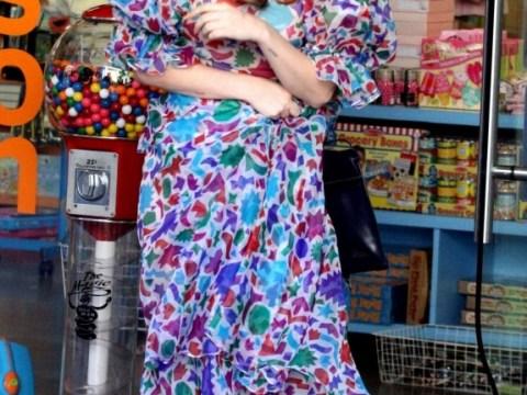 Lady Gaga shows her feminine side in floaty dress while shopping for Elton John's new babe