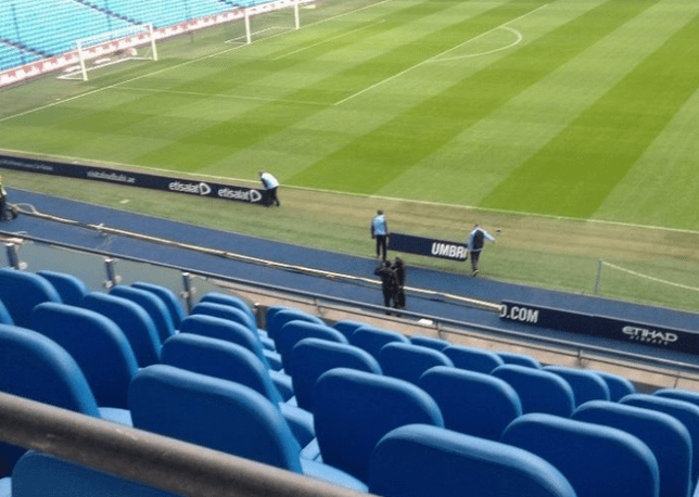 Moving the goalposts: City staff shift the advertising boards (Picture: Sion Parry)