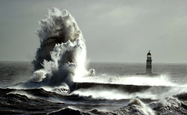 A giant wave caused by strong coastal gales that battered much of the country swamps Seaham harbour in Co Durham