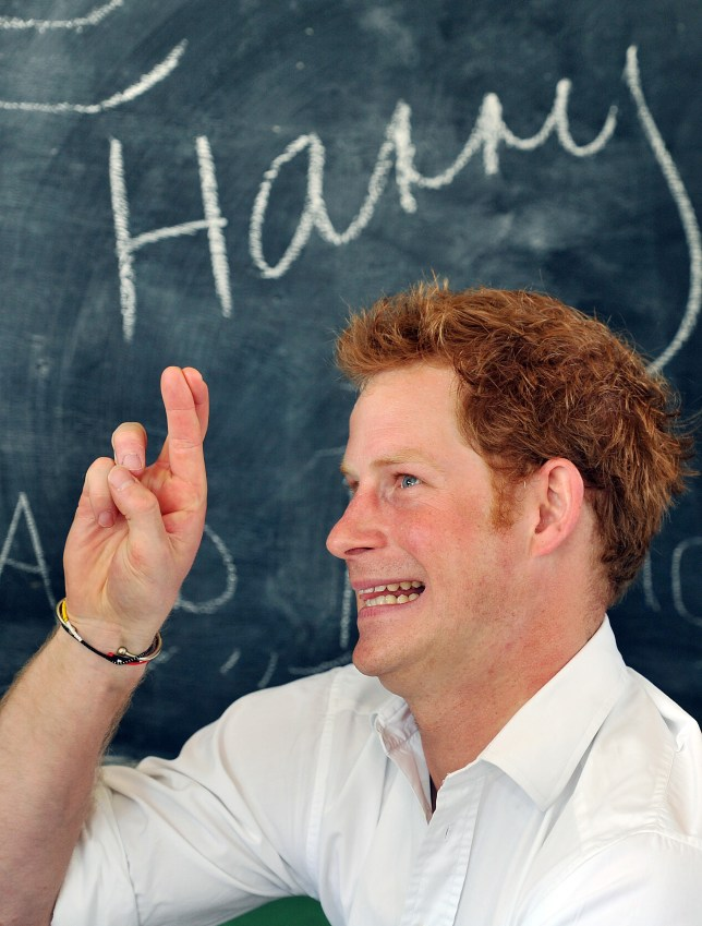 Prince Harry keeping his finger's crossed. Pic: John Stillwell/PA Wire